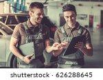 handsome young auto mechanics... | Shutterstock . vector #626288645