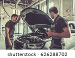 handsome young auto mechanics... | Shutterstock . vector #626288702