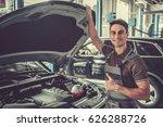 handsome young auto mechanic in ... | Shutterstock . vector #626288726