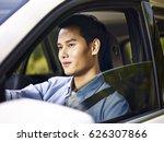 young asian man driving a... | Shutterstock . vector #626307866