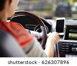 female driver using cellphone... | Shutterstock . vector #626307896