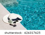 hat and sunglasses at the side... | Shutterstock . vector #626317625