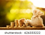 money bag and stacking golds... | Shutterstock . vector #626333222