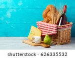 basket with wine bottle  bread... | Shutterstock . vector #626335532
