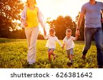 cute girl and boy with parents... | Shutterstock . vector #626381642