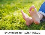 woman feet on the green grass... | Shutterstock . vector #626440622
