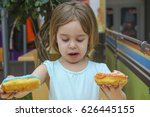 a small charming child holds a... | Shutterstock . vector #626445155