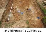 Small photo of archaeological dig site of two bodies