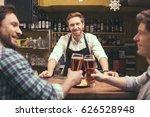 friends having fun in pub   Shutterstock . vector #626528948