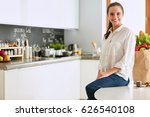 young woman sitting a table in... | Shutterstock . vector #626540108