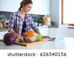 young woman cutting vegetables... | Shutterstock . vector #626540156