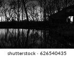 sunset in moody dark forest.... | Shutterstock . vector #626540435