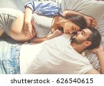 couple in love pregnant lie in... | Shutterstock . vector #626540615