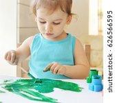 little baby girl painting.... | Shutterstock . vector #626566595