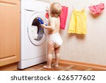 Child Stands Near The Washing...