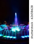 colored water fountain at night | Shutterstock . vector #62658628