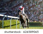 Stock photo horse races jockey and his horse goes towards finish line traditional european sport 626589065
