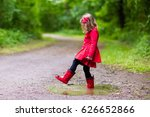 little girl playing in rainy... | Shutterstock . vector #626652866
