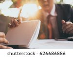 business man showing notebook | Shutterstock . vector #626686886