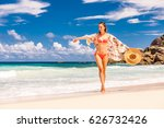 woman with sarong on beach anse ...   Shutterstock . vector #626732426