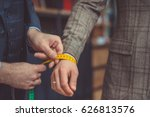 tailor measures a man's hand | Shutterstock . vector #626813576