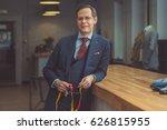 mature tailor in atelier | Shutterstock . vector #626815955