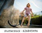 little child enjoys jumping on... | Shutterstock . vector #626845496