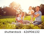 young parents with children on... | Shutterstock . vector #626906132