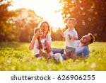family with children blow soap... | Shutterstock . vector #626906255