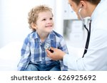 doctor examining a child ... | Shutterstock . vector #626925692