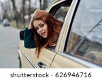 brunette woman driving a car    ... | Shutterstock . vector #626946716