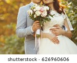 bride and groom on wedding day | Shutterstock . vector #626960606