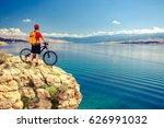 mountain biker looking at view... | Shutterstock . vector #626991032
