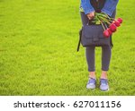 young girl in jeans with... | Shutterstock . vector #627011156