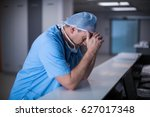 depressed surgeon leaning on... | Shutterstock . vector #627017348