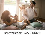 family playing with their two... | Shutterstock . vector #627018398