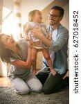 happy family sitting  on floor... | Shutterstock . vector #627018452
