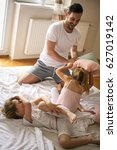 pillow fight. father playing on ... | Shutterstock . vector #627019142
