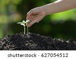 children's hand watering a... | Shutterstock . vector #627054512