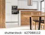 Stock photo new white kitchen with island table and chairs 627088112