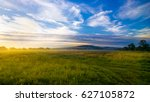 sunrise on foggy day over... | Shutterstock . vector #627105872