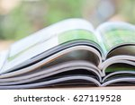stack of magazines open page on ... | Shutterstock . vector #627119528