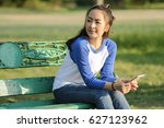 Woman Sit On Chair In Park For...