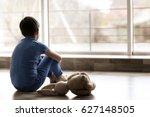 Sad Little Boy Sitting On Floor ...