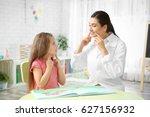 young woman teacher and little... | Shutterstock . vector #627156932