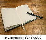 notebook or journal with pen on ... | Shutterstock . vector #627173096