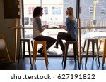 two female friends meeting in... | Shutterstock . vector #627191822