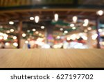 empty wooden table in front of... | Shutterstock . vector #627197702
