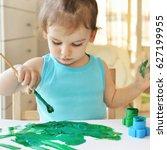 little baby girl painting.... | Shutterstock . vector #627199955