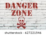 Small photo of Danger Red Tape Warning in front on a white wall.